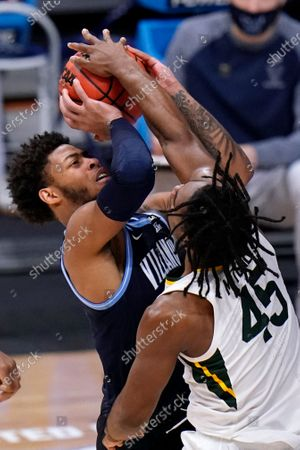 Baylor guard Davion Mitchell (45) blocks a Villanova guard Justin Moore (5) shot in the second half of a Sweet 16 game in the NCAA men's college basketball tournament at Hinkle Fieldhouse in Indianapolis