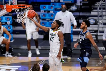 Baylor guard Davion Mitchell (45) drives past Villanova guard Justin Moore (5) in the second half of a Sweet 16 game in the NCAA men's college basketball tournament at Hinkle Fieldhouse in Indianapolis
