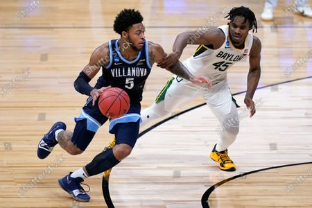Villanova guard Justin Moore (5) drives on Baylor guard Davion Mitchell (45) in the second half of a Sweet 16 game in the NCAA men's college basketball tournament at Hinkle Fieldhouse in Indianapolis