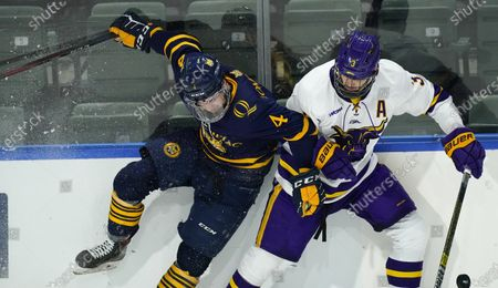Quinnipiac forward Michael Lombardi, left, checks Minnesota St. defenseman Jack McNeely in the second period of an NCAA West Regional college hockey semifinal game, in Loveland, Colo