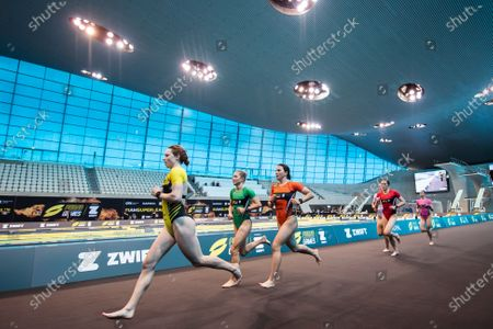 Georgia Taylor-Brown (L) competes during the Super League Triathlon Arena Games held at the London Aquatics Centre, Queen Elizabeth II Olympic Park in London, United Kingdom.