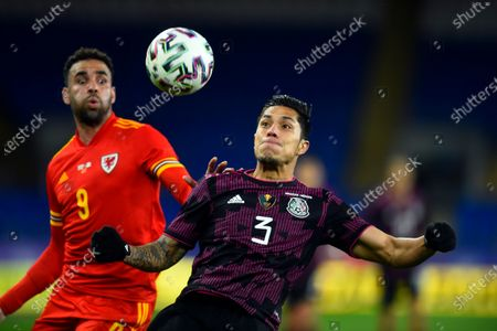 Stock Picture of Hal Robson-Kanu and Carlos Salcedo keep their eyes on the ball