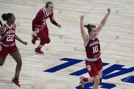 Indiana guard Chloe Moore-McNeil (22), guard Nicole Cardano-Hillary (4) and forward Aleksa Gulbe (10) celebrate their win over North Carolina State in a college basketball game in the Sweet Sixteen round of the women's NCAA tournament at the Alamodome in San Antonio