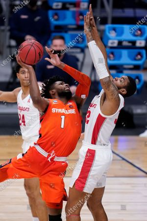 Syracuse forward Quincy Guerrier (1) drives on Houston forward Reggie Chaney (32) in the second half of a Sweet 16 game in the NCAA men's college basketball tournament at Hinkle Fieldhouse in Indianapolis