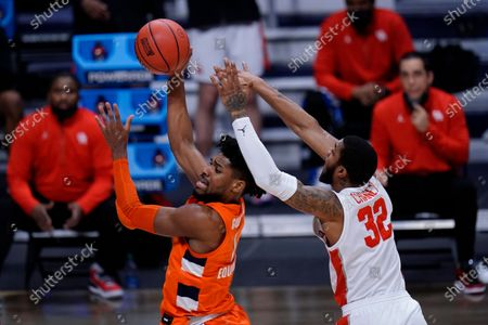 Syracuse forward Quincy Guerrier (1) drives on Houston forward Reggie Chaney (32) in the first half of a Sweet 16 game in the NCAA men's college basketball tournament at Hinkle Fieldhouse in Indianapolis