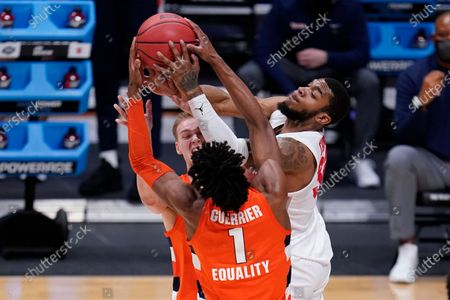 Syracuse forward Quincy Guerrier (1) and Buddy Boeheim (35) battle with Houston forward Reggie Chaney (32) for the ball in the first half of a Sweet 16 game in the NCAA men's college basketball tournament at Hinkle Fieldhouse in Indianapolis