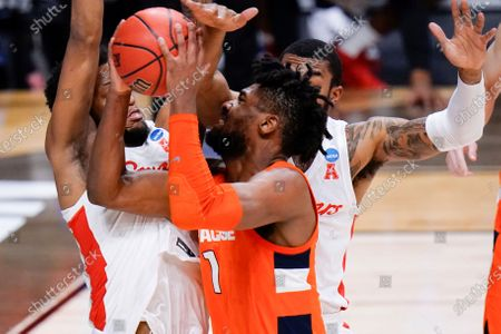Syracuse forward Quincy Guerrier (1) drives on Houston forward Justin Gorham, left, and Reggie Chaney, right, in the first half of a Sweet 16 game in the NCAA men's college basketball tournament at Hinkle Fieldhouse in Indianapolis