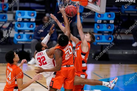 Houston forward Reggie Chaney (32) has his shot blocked by Syracuse forward Marek Dolezaj (21) as Robert Braswell (20) defends in the first half of a Sweet 16 game in the NCAA men's college basketball tournament at Hinkle Fieldhouse in Indianapolis