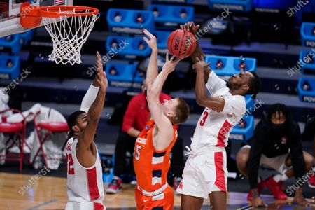 Houston guard DeJon Jarreau (3) blocks the shot of Syracuse guard Buddy Boeheim (35) as Houston forward Reggie Chaney (32) defends in the first half of a Sweet 16 game in the NCAA men's college basketball tournament at Hinkle Fieldhouse in Indianapolis