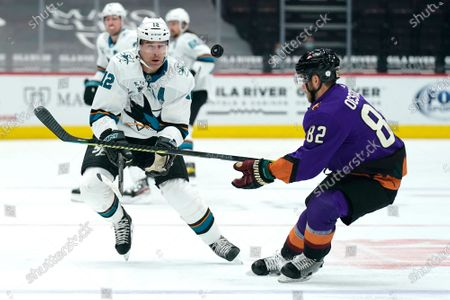 San Jose Sharks center Patrick Marleau (12) and Arizona Coyotes defenseman Jordan Oesterle (82) look for the puck in the first period during an NHL hockey game, in Glendale, Ariz