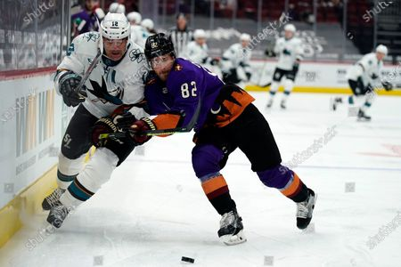 Arizona Coyotes defenseman Jordan Oesterle (82) shields San Jose Sharks center Patrick Marleau from the puck in the first period during an NHL hockey game, in Glendale, Ariz