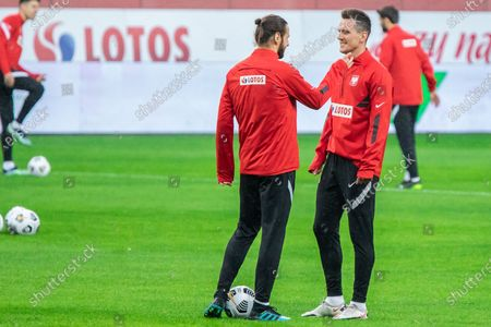 Grzegorz Krychowiak and Arkadiusz Milik of Poland in action during the official training session one day before the FIFA World Cup Qatar 2022 qualification match between Poland and Andorra at Marshal Jozef Pilsudski Legia Warsaw Municipal Stadium.