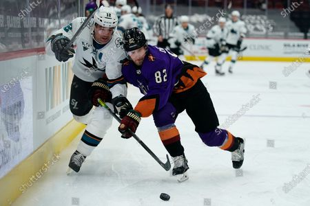 San Jose Sharks center Patrick Marleau (12) and Arizona Coyotes defenseman Jordan Oesterle (82) in the first period during an NHL hockey game, in Glendale, Ariz