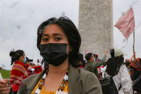 Thet-Su Tin participates in a protest near the Washington Monument against the Myanmar coup on March 27, 2021. Tin said that over 100 tribes were out in solidarity among the demonstrators to reject the Myanmar military and ask President Biden to use his power to help put pressure on the United Nations to bring peacekeepers and humanitarian aid to Myanmar. Tin said that the Myanmar military has broken 10 of the 11 Geneva laws and have not faced any accountability.