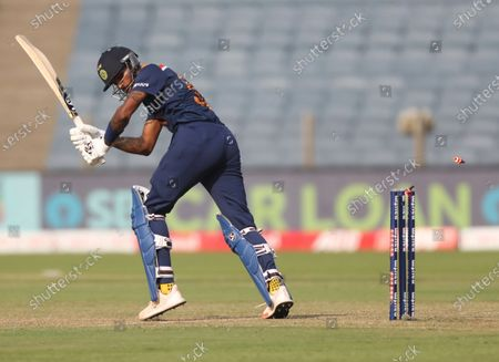 India's Hardik Pandya is bowled out by England's Ben Stokes during the third One Day International cricket match between India and England at Maharashtra Cricket Association Stadium in Pune, India