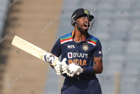 India's Hardik Pandya reacts after he is bowled out by England's Ben Stokes during the third One Day International cricket match between India and England at Maharashtra Cricket Association Stadium in Pune, India