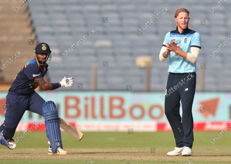 England's Ben Stokes, right, reacts after bowling a delivery during the third One Day International cricket match between India and England at Maharashtra Cricket Association Stadium in Pune, India