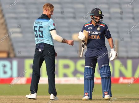India's Shardul Thakur, right, interacts with England's Ben Stokes after hitting a six on his delivery during the third One Day International cricket match between India and England at Maharashtra Cricket Association Stadium in Pune, India