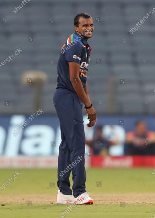 Stock Photo of India's T Natrajan celebrates the dismissal of England's Ben Stokes during the third One Day International cricket match between India and England at Maharashtra Cricket Association Stadium in Pune, India