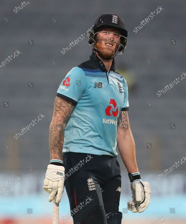 England's Ben Stokes reacts as he walks off the field after losing his wicket during the third One Day International cricket match between India and England at Maharashtra Cricket Association Stadium in Pune, India