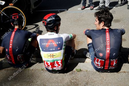 Overall winner British cyclist Adam Yates (C) of Ineos team chats with his team-mates Richie Porte (L) from Australia, who was the runner-up and Geraint Thomas from the Britain, who finished third, after the seventh and last stage of La Volta a Catalunya cycling race, over 133 km starting and finishing in Barcelona, Catalonia, north-eastern Spain, 28 March 2021.