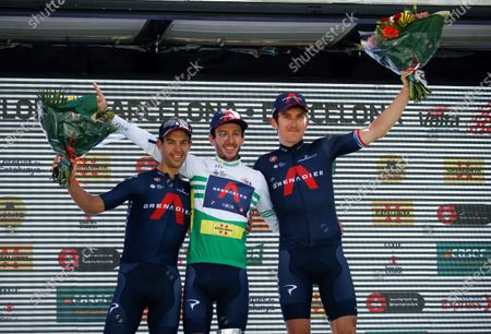 Overall winner British cyclist Adam Yates (C) of Ineos Grenadier team, celebrates on the podium with his team-mates Richie Porte (L) from Australia, who was the runner-up, and Geraint Thomas from Britain who finished third after the seventh and last stage of La Volta a Catalunya cycling race, over 133 km starting and finishing in Barcelona, Catalonia, north-eastern Spain, 28 March 2021.