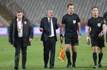 Serbia's coach Dragan Stojkovic reacts as his counterpart Portugal's Fernando Santos complains