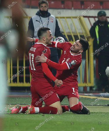 Serbi's Filip Kostic (17) celebrates with his teammate Nemanja Radonjic after scoring the second goal