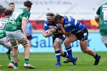 Henry Thomas of Bath Rugby takes on the London Irish defence wih support from team-mate Juan Schoeman