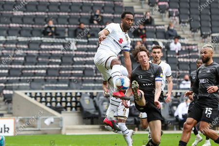 Stock Image of Milton Keynes Dons Cameron Jerome during the second half of the Sky Bet League One match between MK Dons and Doncaster Rovers at Stadium MK, Milton Keynes on Saturday 27th March 2021.
