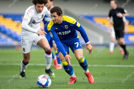 Cheye Alexander of AFC Wimbledon controls the ball during the Sky Bet League 1 match between AFC Wimbledon and Northampton Town at the Plough Lane, Wimbledon, England on 27th March 2021.