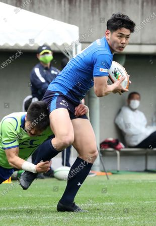 Panasonic Wild Knights wing back Koki Takeyama carries the ball at a match of Japan Rugby Top League 2021 tournament at the Prince Chichibu stadium in Tokyo on Sunday, March 28, 2021. Panasonic Wild Knights defeated NEC Green Rockets 62-5.