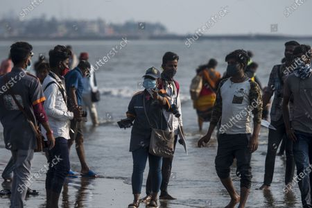 Cleanup Marshall fine people for not wearing face mask at Juhu beach, on March 27, 2021 in Mumbai, India.