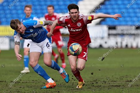 Stock Image of Paul Smyth of Accrington Stanley and Frankie Kent of Peterborough United battle for possession during the Sky Bet League 1 match between Peterborough United and Accrington Stanley at Weston Homes Stadium, Peterborough on Saturday 27th March 2021.