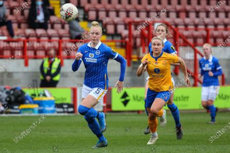 Izzy Christiansen (Everton 8) chases down Danique Kerkdijk (Brighton 5) during the Barclays FA Womens Super League game between Brighton & Hove Albion and Everton at The People's Pension Stadium in Crawley.