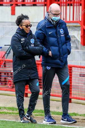 Stock Image of Hope Powell (Brighton Manager) in warm up during the Barclays FA Womens Super League game between Brighton & Hove Albion and Everton at The Peopleâ€s Pension Stadium in Crawley.