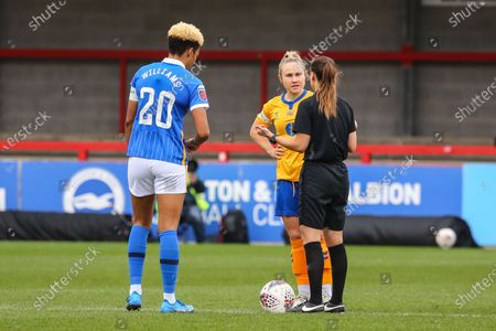 Victoria Williams (Brighton 20) and Izzy Christiansen (Everton 8) meet with referee before kick off during the Barclays FA Womens Super League game between Brighton & Hove Albion and Everton at The Peopleâ€s Pension Stadium in Crawley.