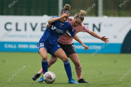 Stock Image of Danielle Brown (#19 Durham) recieves pressure from Nat Johnson (#3 Sheffield United) during the FA Women's Championship game between Durham and Sheffield United at Maiden Castle