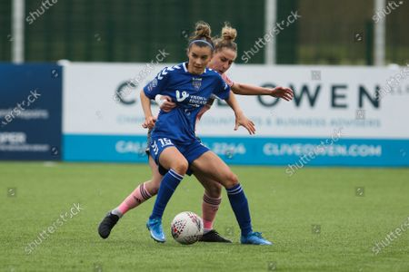 Stock Picture of Danielle Brown (#19 Durham) is put under pressure from Nat Johnson (#3 Sheffield United) during the FA Women's Championship game between Durham and Sheffield United at Maiden Castle in Durham, England