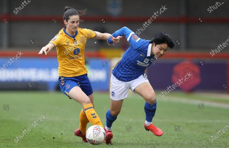 Stock Image of Geum-Min Lee of Brighton and Hove Albion and Abbey Stringer of Everton challenge for the ball