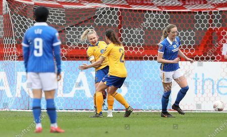 Izzy Christiansen (L) of Everton celebrates after she scores a penalty to make it 1-0