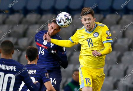 France's Adrien Rabiot, left, and Kazakhstan's Ramazan Karimov challenge for the ball during the World Cup 2022 group D qualifying soccer match between Kazakhstan and France at the Astana Arena stadium in Nur-Sultan, Kazakhstan