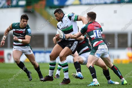 Luther Burrell of Newcastle Falcons takes on the Leicester Tigers defence
