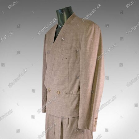 Stock Picture of A stylish suit discarded by David Bowie after he spilt cigarette ash on it today sold for £10,000.  The late icon wore the Japanese-made beige Issey Miyake suit to a London nightclub in 1982.  He ditched it during the raucous night after a lit cigarette burnt a hole in it.  Bowie, then aged 35, asked his assistant to fetch his suitcase from the car so he could change into a different outfit.