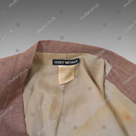 A stylish suit discarded by David Bowie after he spilt cigarette ash on it today sold for £10,000.  The late icon wore the Japanese-made beige Issey Miyake suit to a London nightclub in 1982.  He ditched it during the raucous night after a lit cigarette burnt a hole in it.  Bowie, then aged 35, asked his assistant to fetch his suitcase from the car so he could change into a different outfit.