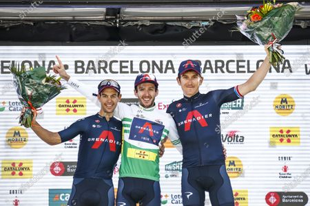 43 Adam Yates from Great Britain, 44 Geraint Thomas from Great Britain and 41 Richie Porte from Australia of Ineos Grenadiers at the podium celebrating their result during the 100th Volta Ciclista a Catalunya 2021, Stage 7 from Barcelona to Barcelona. On March 28, 2021 in Barcelona, Spain.
