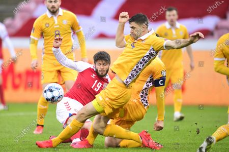 Stock Photo of Denmark's Lasse Schone (L) in action during  the FIFA World Cup 2022 qualifiers match between Denmark and Moldova in Herning, Denmark, 28 March 2021.