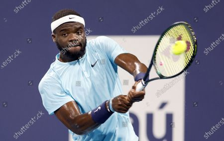 Frances Tiafoe of the USA in action against Dusan Lajovic of Serbia during their Men's singles match at the Miami Open tennis tournament in Miami Gardens, Florida, USA, 28 March 2021.