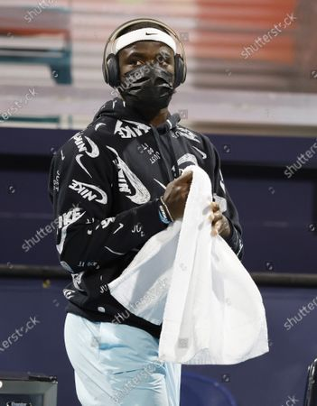 Frances Tiafoe of the USA wears a mask as he enters the courts against Dusan Lajovic of Serbia during their Men's singles match at the Miami Open tennis tournament in Miami Gardens, Florida, USA, 28 March 2021.