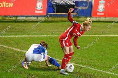 Blackburn Rovers defender Chelsey Jukes (2) challenges Liverpool Women's forward Ashley Hodson (14) during the FA Women's Championship match between Liverpool Women and Blackburn Rovers Women at Prenton Park, Birkenhead